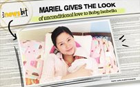 Mariel gives the look of unconditional love to Baby Isabella