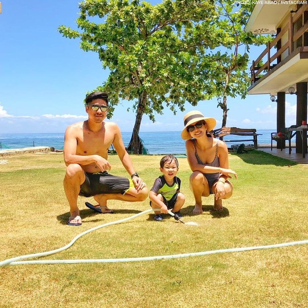 Kaye Abad and Paul Jake Castillo with their son at their beach resort