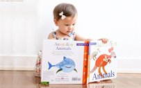 Baby Dahlia is already a bookworm at 11 months old!