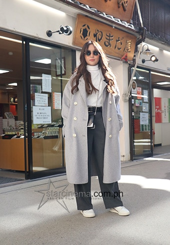 Kathryn went for clean lines, mixing whites and grays and oversized fits for a totally fire outfit.