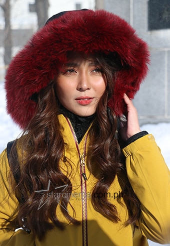 Kathryn wore big waves throughout the trip for that winter wonderland vibe!