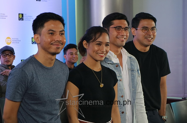 The cast and director of
