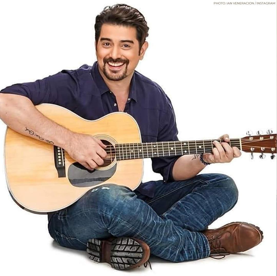 The way Ian Veneracion holds his guitar