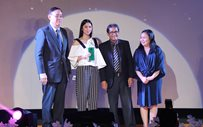 Julia and Awra receive their trophies at the Platinum Stallion Media Awards