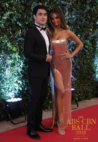 Vavavoom! Pia Wurtzbach, who went full glam for the event, brought the handsomest accessory known to man, Marlon Stockinger